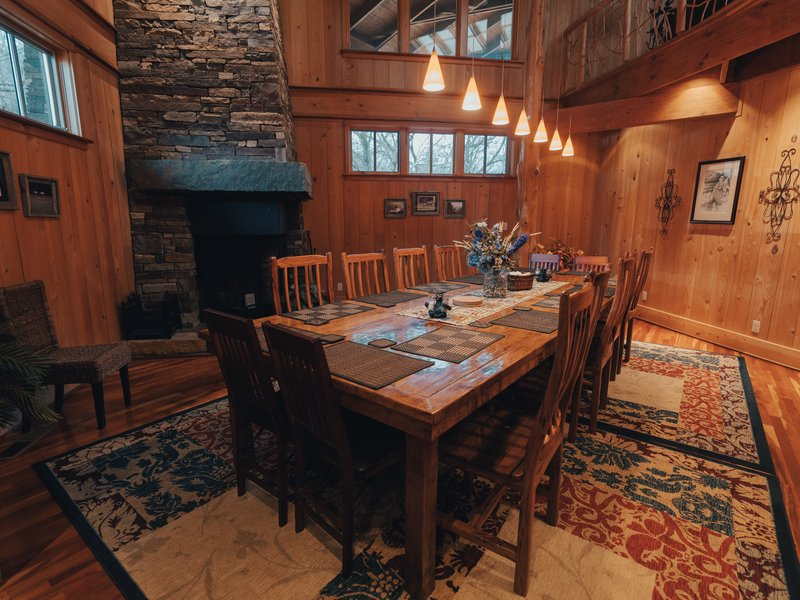 A 14-person, custom-built dining table graces the lodge's formal dining area.