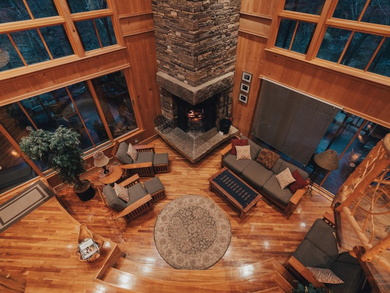 A view of Cedar Crest Lodge's sunken living room from the second-story gathering area.