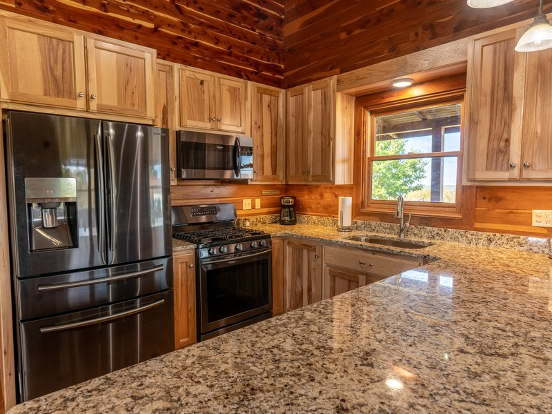 The Big Sky Cabin's fully furnished kitchen