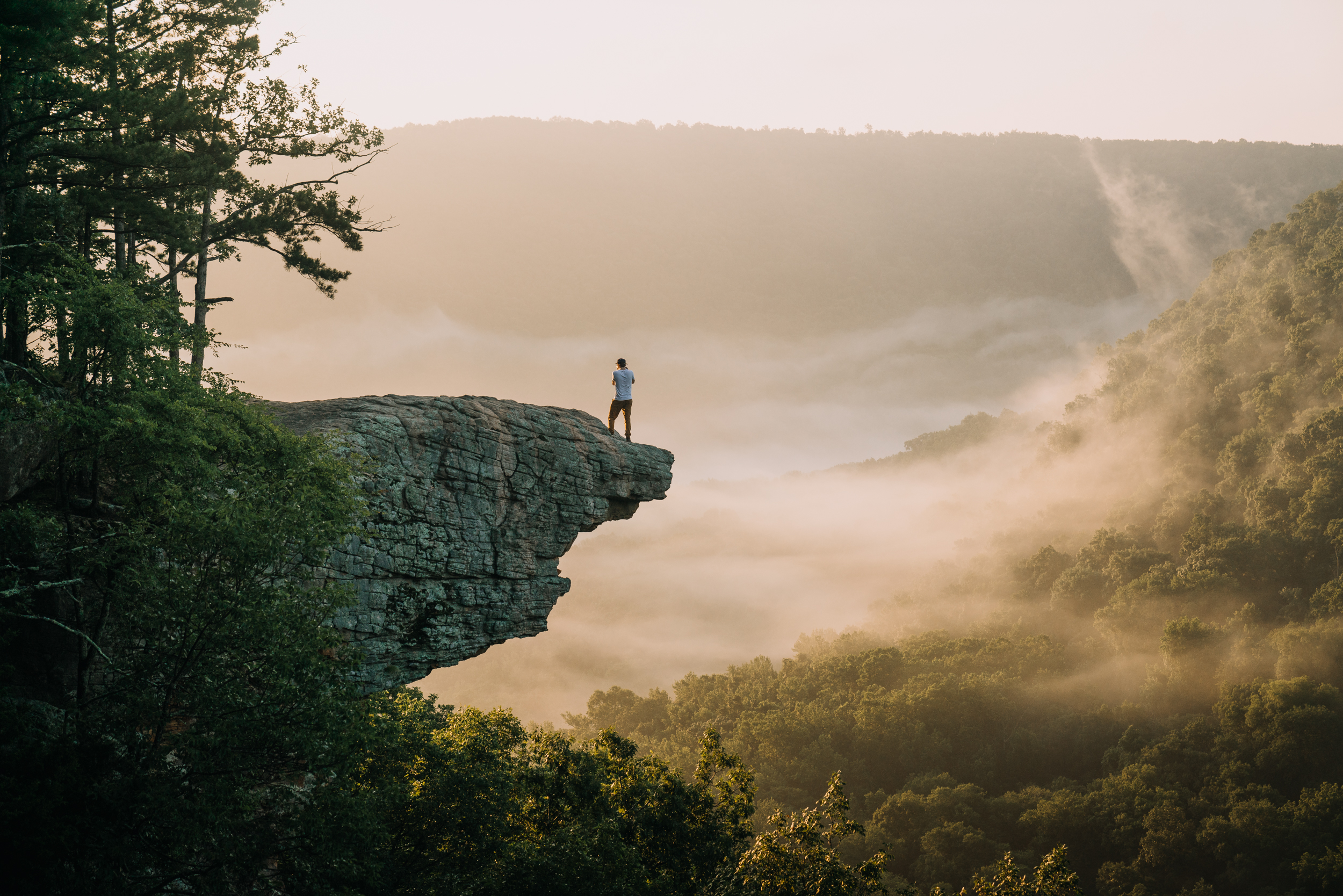 Hiker on Whitaker Point (Hawksbill Crag)