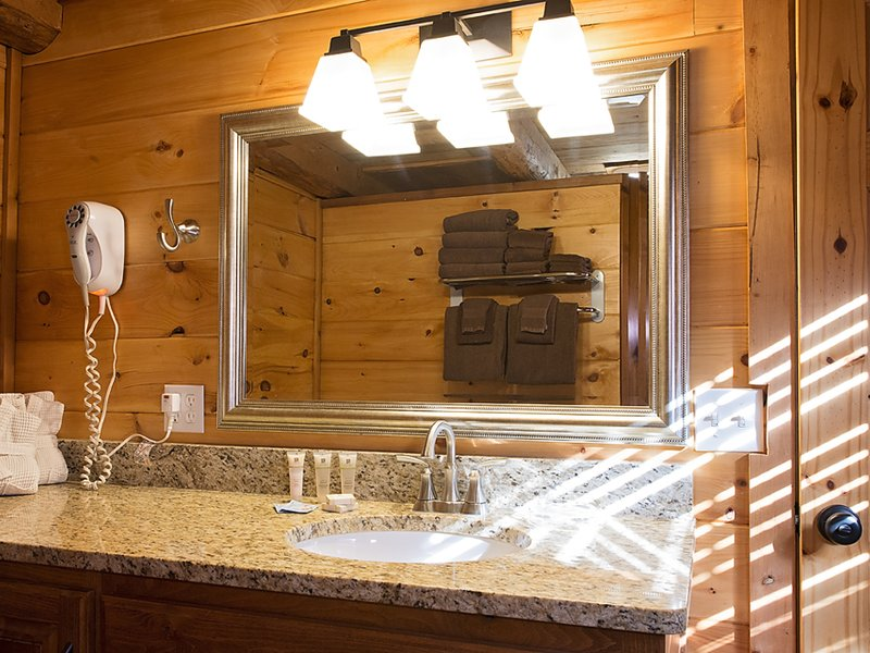 The Balloon Cabin features a bathroom with a nice sink area, toilet and large walk-in shower.