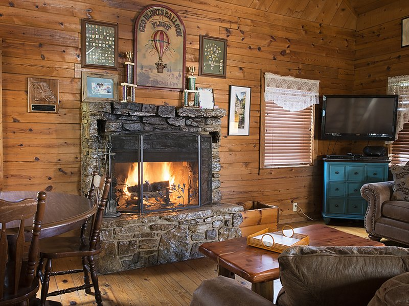 Enjoy the beauty and comfort of a cozy fire in the Balloon Cabin's living area.
