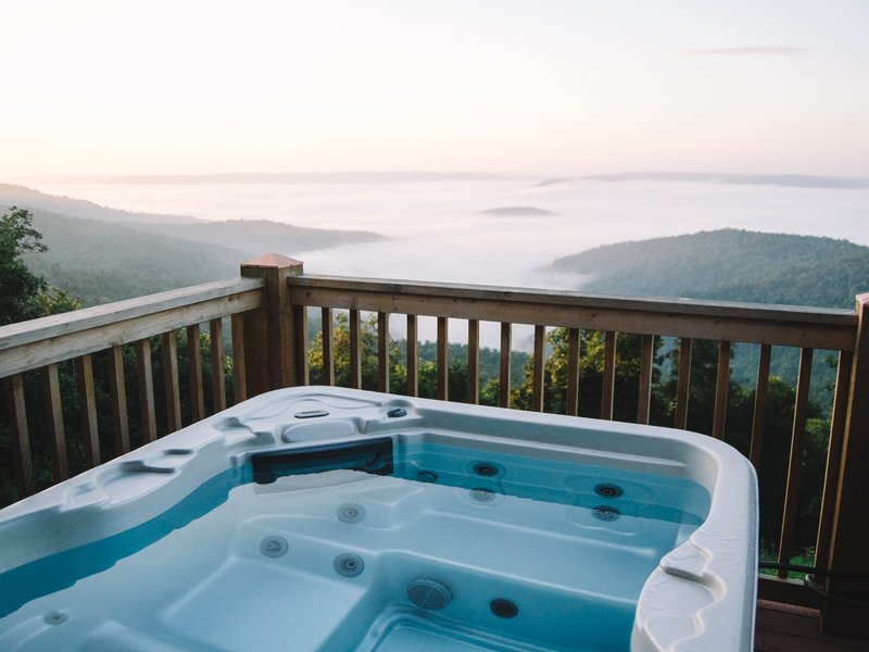 Sit back, relax and enjoy the view from the cabin's hot tub