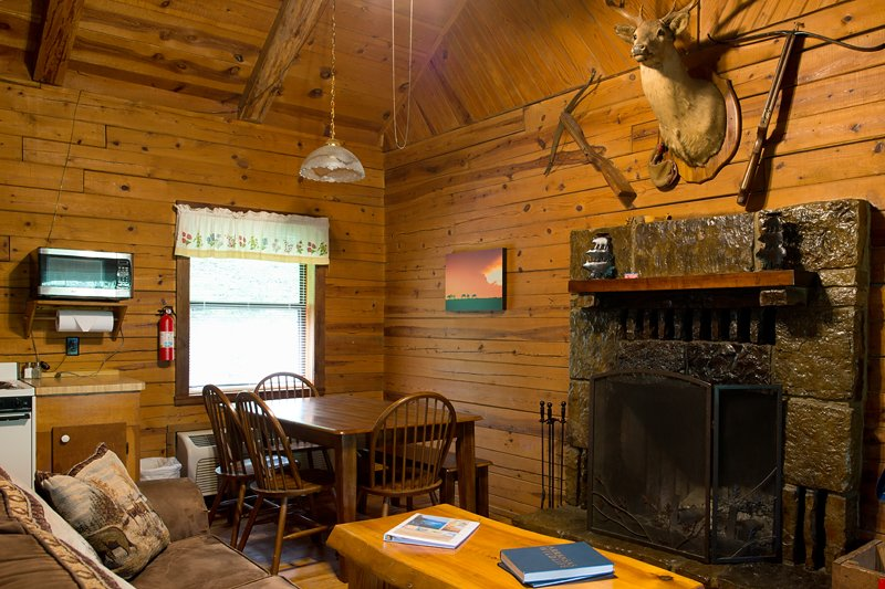 The dining and living area of the Crossbow Cabin.