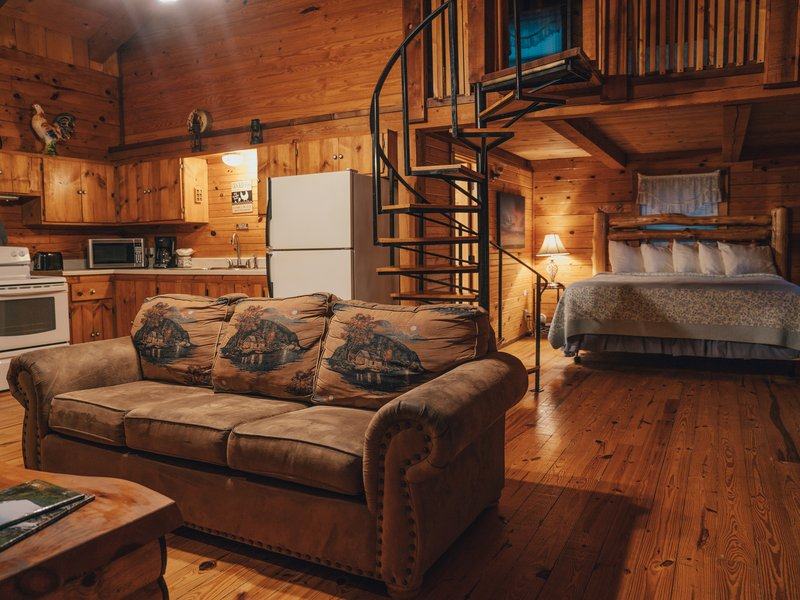 The Mountain Magic Cabin partial living/kitchen area view