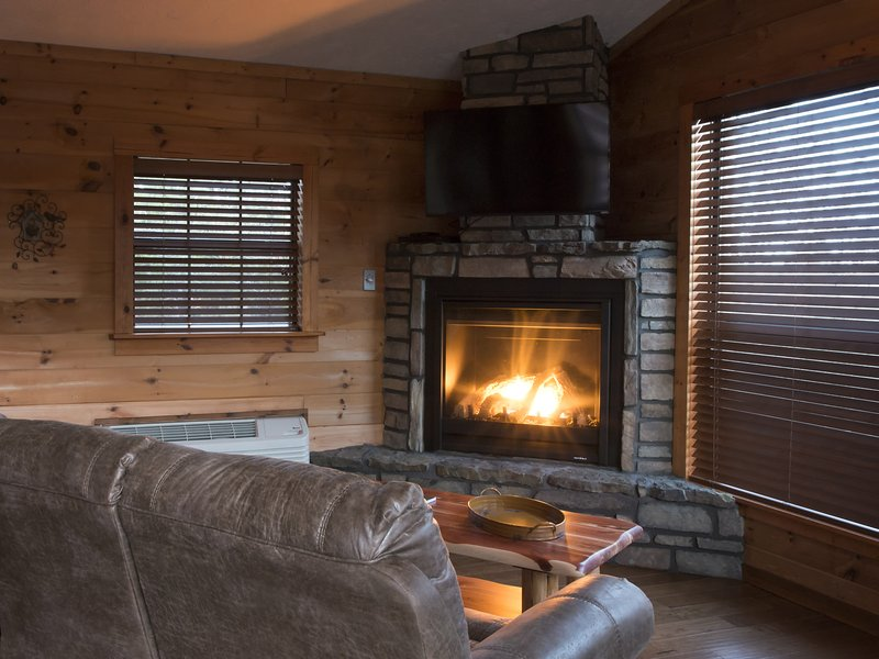 Relax beside the cabin's cozy fireplace