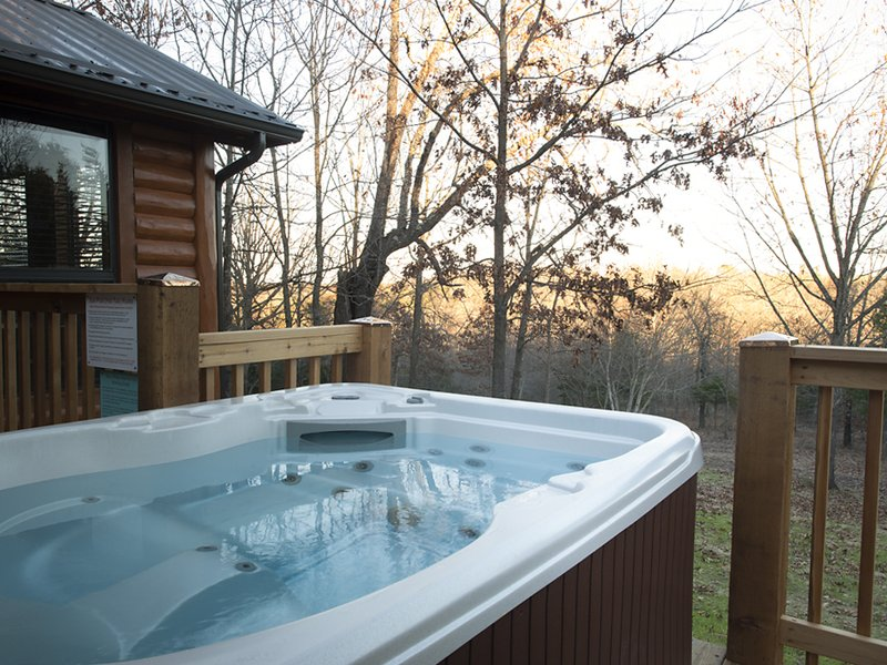 with arkansas bungalow bed springs in romantic cabin and breakfast hot knotty cabins tubs nice