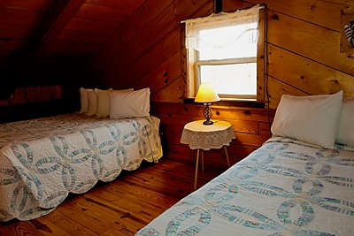 Upstairs are two queen beds in the Mountain Magic Cabin