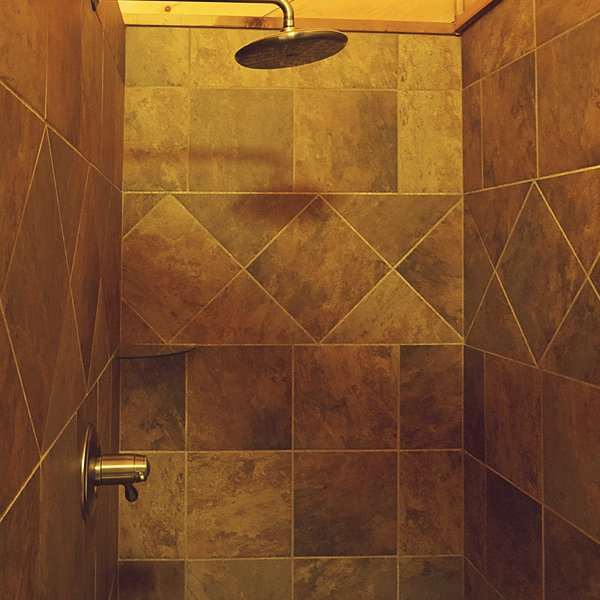 The cabin's tile shower with rainshower head.