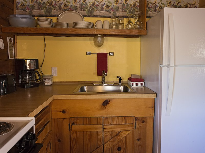 The cabin's kitchen is fully furnished, including coffeemaker and full-size fridge.
