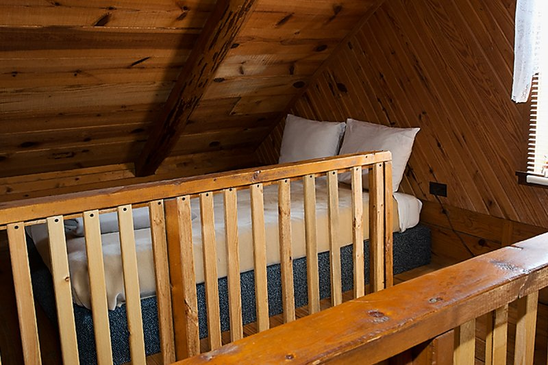 The upstairs loft offers two full-size beds (1 bed is not shown here)
